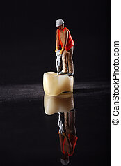 tooth crown with miniature employee