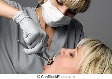tooth extraction using forceps, special dental instrument for teeth removal