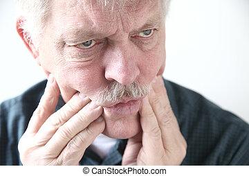 tooth or cheek pain in older man