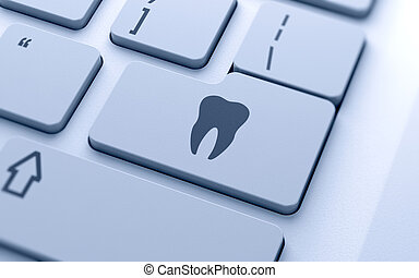 Tooth sign button on keyboard with soft focus