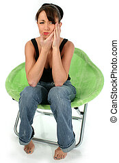 Toothache - Beautiful young woman holding face in pain. Shot...