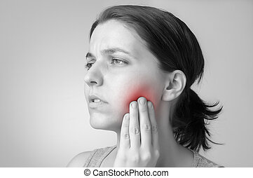 Young woman having toothache