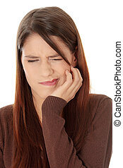 Toothache - Young woman in pain is having toothache isolated...