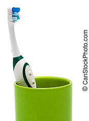 Toothbrush in a green glass