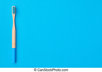 Toothbrush on blue background top view