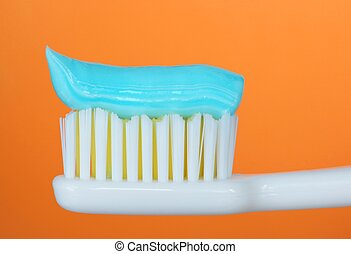 Toothbrush, orange background