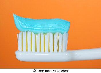 Toothbrush, orange background