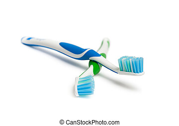 Toothbrush - Two toothbrushes. Focus is pointed at the blue ...