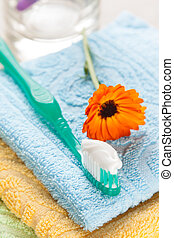 Toothbrush with toothpaste on fresh towels