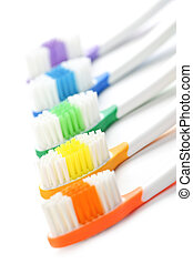 Toothbrushes - Close up of multicolored toothbrushes on ...
