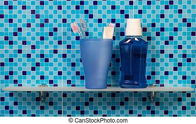 Toothbrushes on bathroom shelf