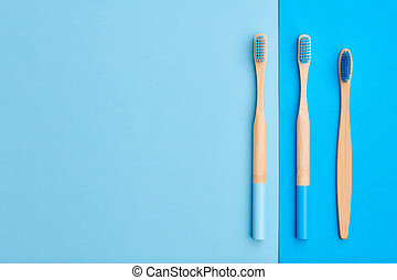 Toothbrushes on blue background top view
