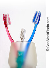 Toothbrushes08 - family of toothbrushes in a cup isolated...