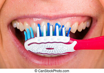 Toothbrushing - Close up photo of tooth cleaning with...