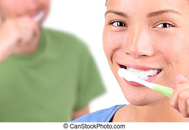 toothbrushing - Young couple brushing teeth together on ...