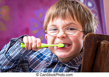 Toothless boy brushing his teeth with a toothbrush