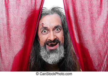 Toothless man between curtain against white background