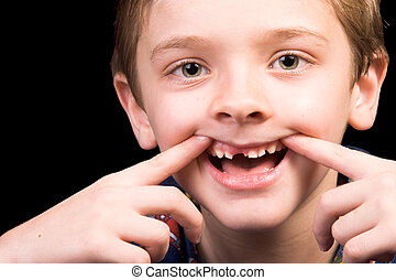 Toothless - Young boy with beautiful green eyes who has one...