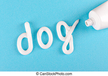 toothpaste for dogs, animal teeth care concept, on blue...