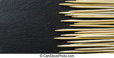 Toothpick on a black background. Not an even number.
