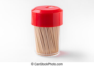 Toothpicks in a box on a white background. Closed bottle with toothpicks
