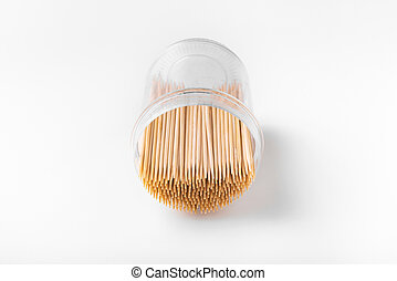 Toothpicks in a box on a white background. Inverted bottle with toothpicks