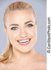 toothy, femme, rayonner, blonds, sourire, heureux