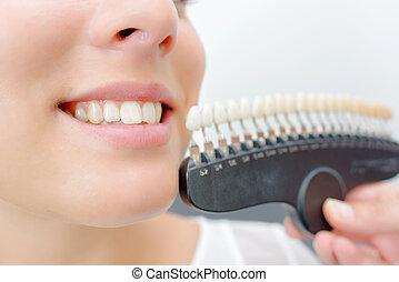 Toothy smile next to sample false teeth