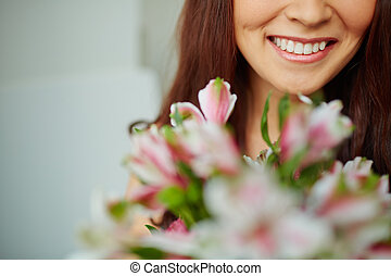 Toothy smile - Close-up of female toothy smile and flowers