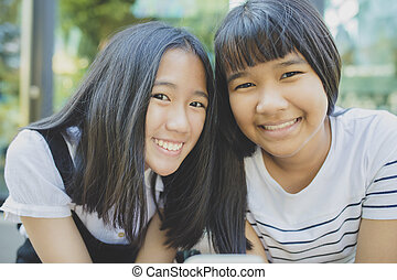 toothy smiling face of asian teenager happiness emotion
