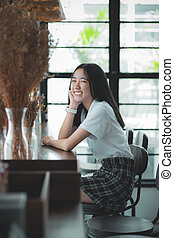 toothy smiling face of asian teenager looking with eye ...