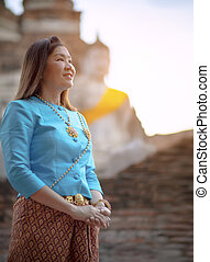 toothy smiling face of asian woman standing in ayuthaya...