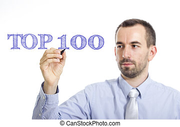 Top 100 - Young businessman writing blue text on transparent surface