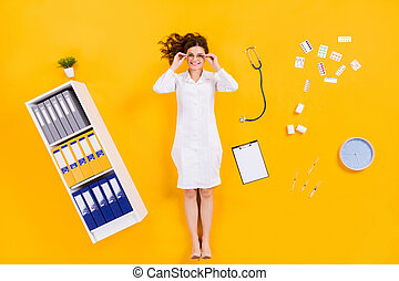 Top above high angle view full length photo of qualified woman doc flat lay pills drugs clipboard syringe clock touch specs in medical office isolated over bright shine color background