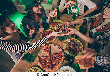 Top above high angle view of her she his he nice stylish look attractive cheerful cheery positive group of people guys tasting delicacy event evening having fun in house indoors