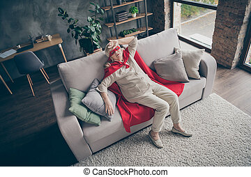 Top above high angle view of her she nice attractive tired sick ill gray-haired grandma wearing red costume lying on divan at industrial brick loft modern style interior house flat