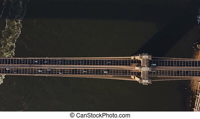 Top Aerial view of Brooklyn bridge in New York, America. Drone flying over the traffic road, road junction in Manhattan.