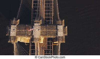 Top aerial view of Brooklyn bridge, over the East river in New York, America. Scenic landscape of USA sight.