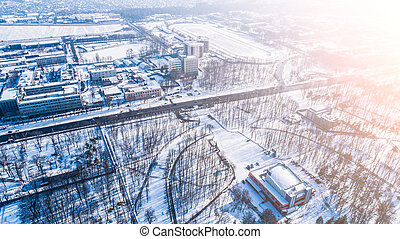Top aerial view of empty city park in winter with snow