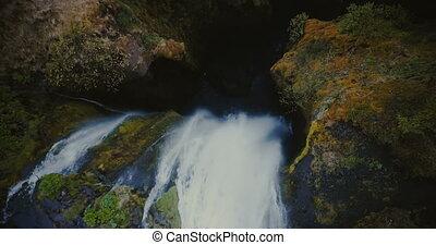Top aerial view of the beautiful Gljufrabui waterfall in...