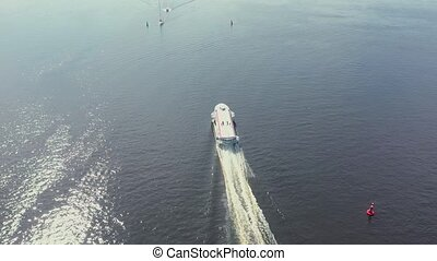 Top aerial view of the speedboat in the bay