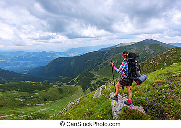 top - alone tourist in high mountain