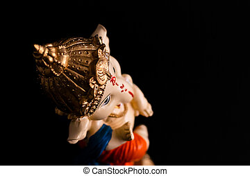 top angle shot of beautiful ganesha statue on black background. hindu and culture concept