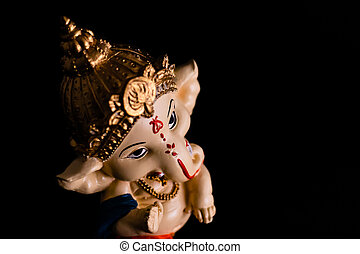 top angle view of beautiful ganesha statue giving blessing with black background. culture and hinduism concept