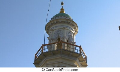 Top balcony of a tower - A steady, low angle, medium shot of...