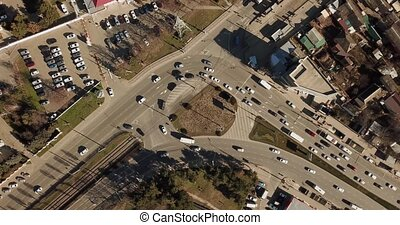 Top down aerial drone footage of a medium sized roundabout...