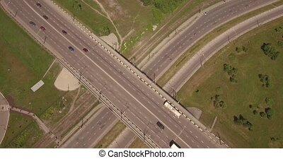 Top down aerial view of crossroad with car traffic in...