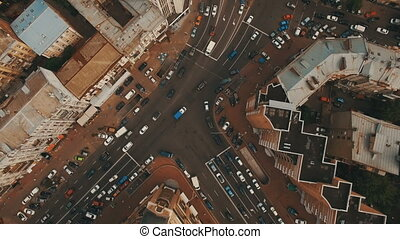 Top down aerial view of intersection with a lot of cars