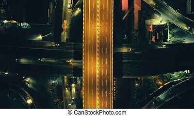 Top down city illuminate roadway at night cityscape aerial ...