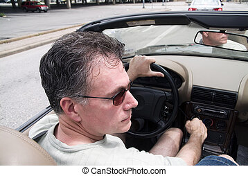 Top Down Driving - Man in a convertible driving with the top...
